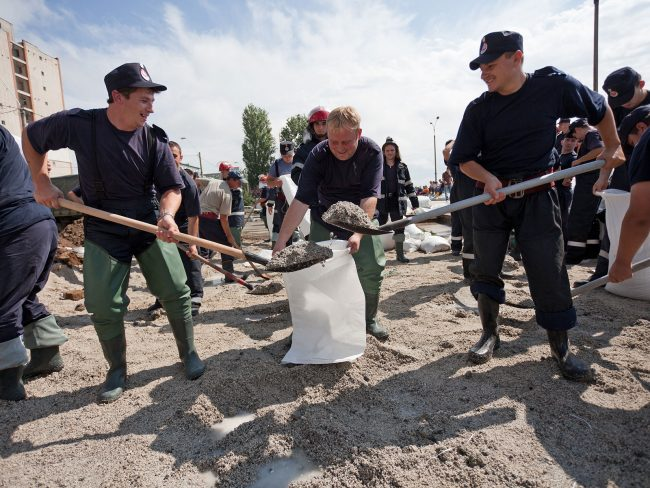 Soldiers are seen filling bags with sand to protect against flooding of the Danube river in Galați, Romania on July 6th, 2010, following a flood warning caused by the river's record flow rate.