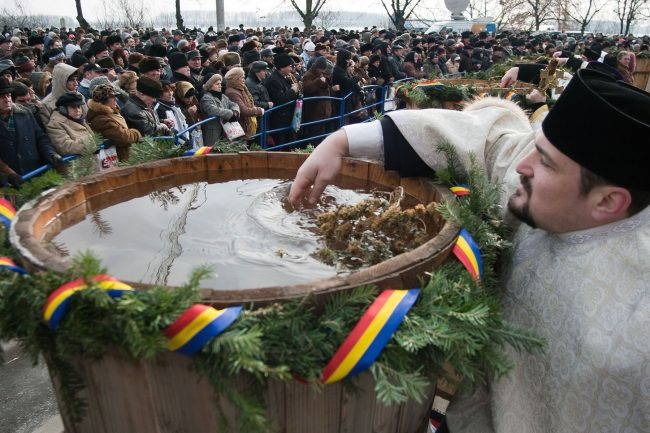 A priest sanctifies the water in Epiphany ceremony that took place in Galați, Romania on January 6th, 2009.