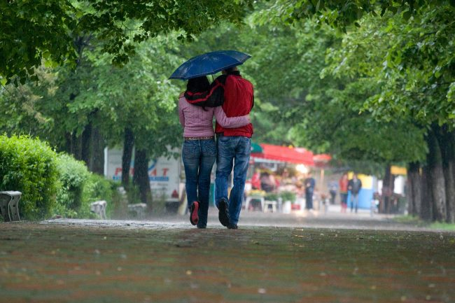 A young couple is walking in the park during a torrential rain in Galați, Romania on May 4th, 2008.