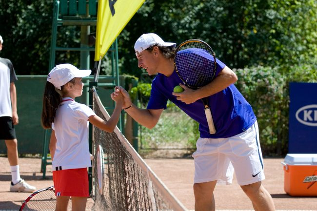 Romanian tennis player Andrei Pavel is greeting a little girl in Galați, Romania on July 30th, 2008.