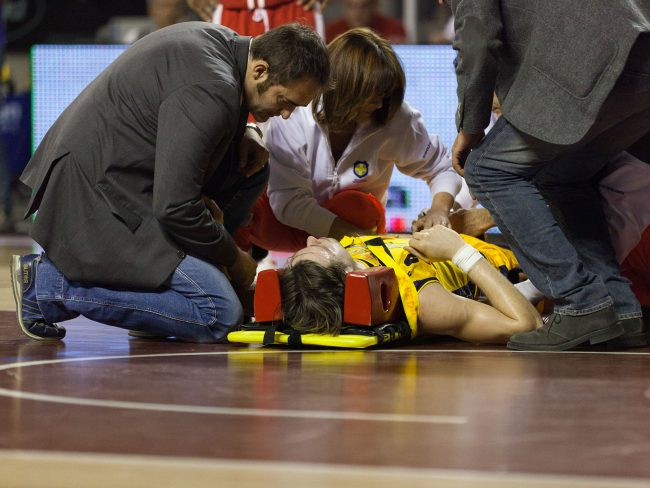 A basketball player from Sutor Montegranaro (IT) is lying on the ground after an injury in the match against Scavolini Pesaro (IT) in Ancona, Italy on April 16th, 2011.