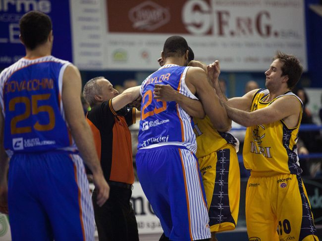 Two basketball players are having a fight during a match between ENEL Brindisi (IT) and Sutor Montegranaro (IT) in Porto San Giorgio, Italy on March 27th, 2011