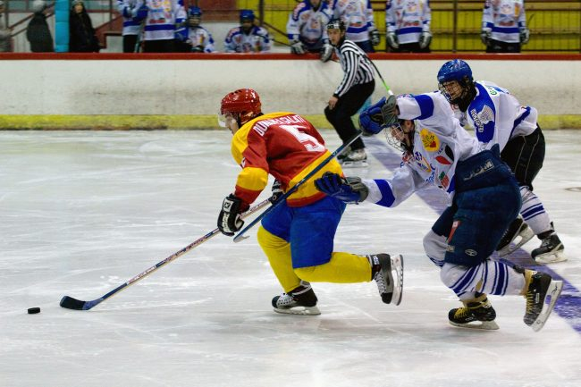 Hockey players are fighting for the puck in a game played in Galați, Romania on January 10th, 2008.