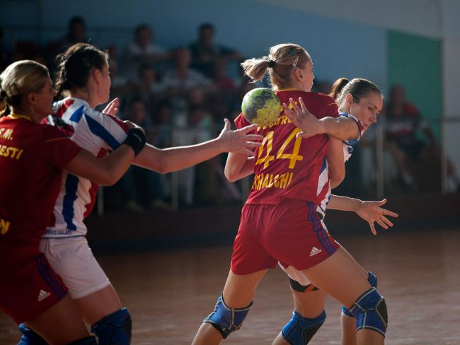 Handball players are fighting for the ball in a game played in Galati, Romania on September 6th, 2012.