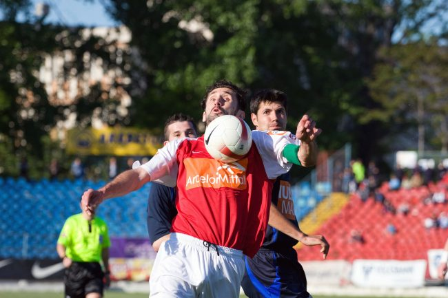 Football players are fighting for the ball in a game played in Galați, Romania on May 6th, 2008.